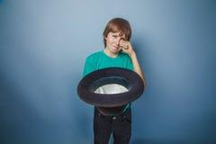European-looking boy of ten years beggar, poor Stock Images
