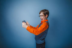 European-looking boy of ten years in glasses plays Stock Photography