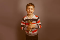European-looking boy of ten years  holding a cup Stock Photo