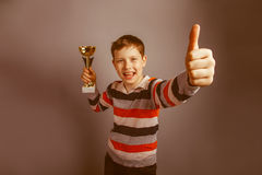 European-looking boy of ten years holding a cup Royalty Free Stock Photo