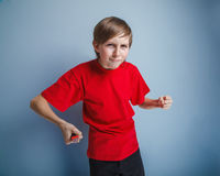 European-looking boy of ten years holding a knife Stock Photo