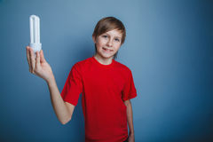 European-looking boy of ten years holding a light Royalty Free Stock Photo