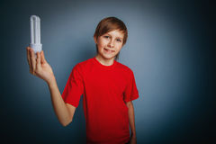 European-looking boy of ten years holding a light Stock Images