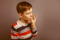European-looking boy  of ten  years licks his Stock Photography
