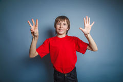 European-looking boy of ten years shows a figure Stock Photo