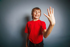 European-looking boy of ten years shows a figure Stock Image