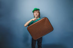 European-looking boy of ten years with a suitcase Stock Images