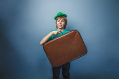 European-looking boy of ten years with a  suitcase Royalty Free Stock Photos