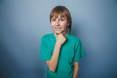 European-looking boy of ten years thinks hand at Royalty Free Stock Photography
