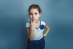 European-looking girl five years his finger in his Stock Photo