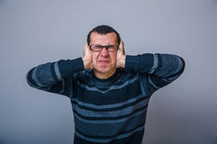 European-looking male covering his ears with hands Stock Images