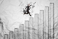 European manager running above growth chart Royalty Free Stock Photos