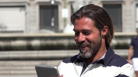 European Male Using Tablet. A European Male Using Tablet Royalty Free Stock Photography