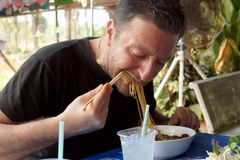 European Man Eating Thai food Royalty Free Stock Photos
