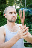 European Man Holding Incense in his hand Royalty Free Stock Image