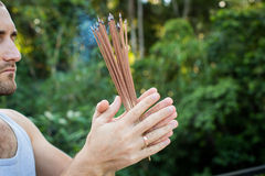 European Man Holding Incense in his hand Royalty Free Stock Images