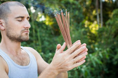 European Man Holding Incense in his hand Royalty Free Stock Photo