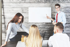 European man showing whiteboard. Handsome european men showing empty whiteboard with copy space to team. Presentation and meeting concept Royalty Free Stock Images