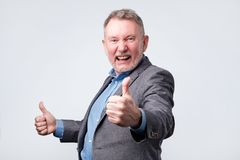 European man in suit showing thumb up royalty free stock images