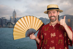 European man in traditional Chinese costume in Hong Kong Royalty Free Stock Photo