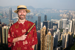 European man in traditional Chinese suit in Hong Kong Royalty Free Stock Images