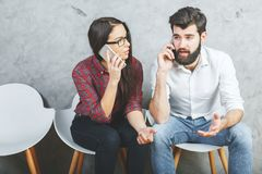 European man and woman with smartphone stock image