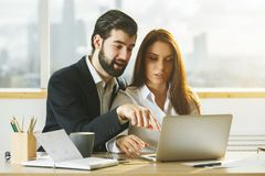 European man and woman working together Royalty Free Stock Photography