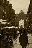 European Market. A busy commercial district, filled with shops and shoppers in sepia Royalty Free Stock Photo