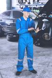 European mechanic working with laptop royalty free stock photo