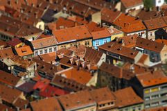 European medieval city view. Miniature tilt shift lens effect. Brasov, Romania Royalty Free Stock Image