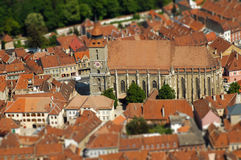 European medieval city view. Miniature tilt shift lens effect. Brasov, Romania Stock Photography