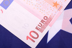 European money on american flag Stock Photography
