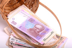 European money on wooden basket, hryvnia, dollars, euro Stock Photography