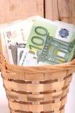 European money on wooden basket Royalty Free Stock Image