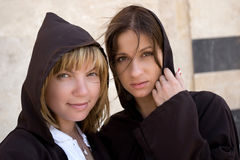 European moslem. Two european girls in cassocks are lokking ang smiling Stock Images