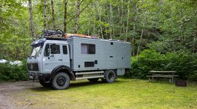 A european motorhome touring america. A sturdy mercedes rv at a campground in aklaska Royalty Free Stock Images