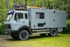 A european motorhome touring america. A sturdy mercedes rv at a campground in aklaska Royalty Free Stock Image