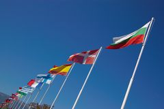 European national flags in row. A row of many european national flags in clear blue sky, horizontal, declined royalty free stock photography
