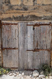 European old doors that have survived the test of time. Ancient wooden door entrance that has stood the test of time Royalty Free Stock Images