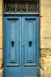 European old doors that have survived the test of time. Beautiful blue door has stood the elements over time Royalty Free Stock Images