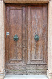 European old doors that have survived the test of time. Faded brown dried out doors Royalty Free Stock Photos