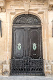 European old doors that have survived the test of time. Gated entrance to an old home Stock Photography