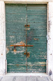 European old doors that have survived the test of time. Old locked door to keep all out or something in Royalty Free Stock Photo