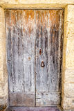 European old doors that have survived the test of time. Once a shade of orange now a faded image of what it once was Stock Image