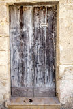 European old doors that have survived the test of time. Paint has long been gone from this old country door Stock Photography