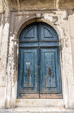 European old doors that have survived the test of time. Wonderful blue old door with streaks of rust Royalty Free Stock Images
