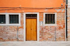 Old house exterior, brick wall and door in Venice, Italy