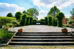 European park with concrete stairs and trimmed trees. stock photos