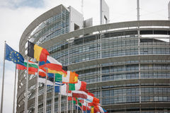 European Parliament building and flags. In Strasbourg, France Stock Photos