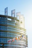 European parliament on a clear day with all EU Flags sunny day Royalty Free Stock Photo